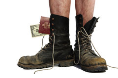 Old boots with legs with money and passport Stock Images