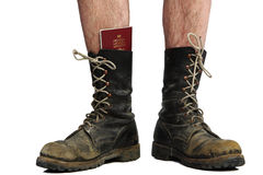 Old boots with legs with money and passport Royalty Free Stock Photos