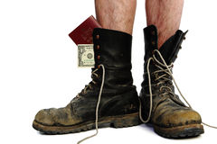 Old boots with legs and money Stock Photos