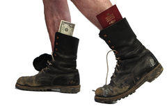 Old boots with legs and money Royalty Free Stock Photography