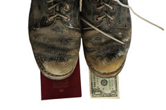 Old boots with legs and money Royalty Free Stock Photo