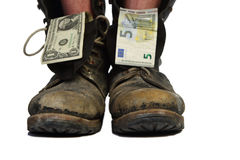 Old boots with legs and money Royalty Free Stock Image