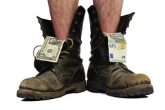Old boots with legs and money Royalty Free Stock Images