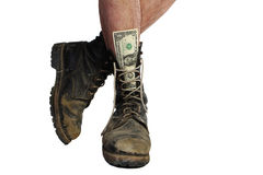 Old boots with legs and money Stock Photo