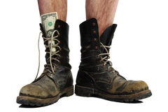 Old boots with legs and money Stock Images