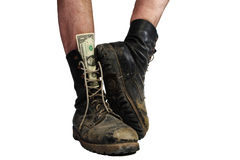 Old boots with legs and money Stock Image