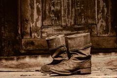 Old boots on a porch Royalty Free Stock Photos
