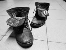 Old boots or old boots on the floor royalty free stock photo
