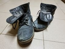 Old boots or old boots on the floor royalty free stock photos