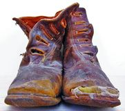Old Boots. A worn out pair of victorian child's  boots Royalty Free Stock Photos