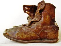 Old Boots. A worn out pair of victorian child's  boots Royalty Free Stock Images