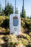 Old border stone with coat of arms of Bavaria on Kleiner Spitz Berg hill in Bavarian Forest mountains Stock Image