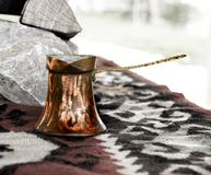 Old bosnian coffee pot. Vintage bosnian coffee maker on rough red, black and white blanket stock images