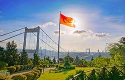 Old Bosphorus Bridge And Turkish Flag in Istanbul - Turkey. View of the Turkish Flag and the Fatih Sultan Mehmet Bridge photo, taken from Otagtepe, Beykoz in stock images