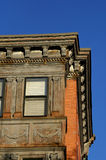 Old boston building. Detail of old building in downtown boston, showing carved details and peeling cracked paint Stock Photo