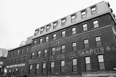 Old Boston Buildings in Black and white. BOSTON, USA - OCTOBER 14, 2014; Old Boston Buildings & Street Scene with faded signage on brick exterior and an out of Royalty Free Stock Photos