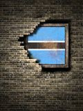 Old Botswana flag in brick wall Stock Images