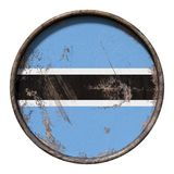 Old Botswana flag. 3d rendering of a Botswana flag over a rusty metallic plate. Isolated on white background Royalty Free Stock Photos