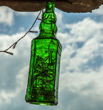 Old bottle as lamp. Stock Image