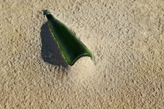 Old bottle on the beach Royalty Free Stock Image