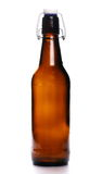 Old bottle of beer with drops isolated on white Stock Photo