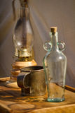 Old Bottle, Lantern, and Drinking Cup. Old empty glass bottle with a cork, lantern, and drinking cup at a Civil War encampment Stock Photos