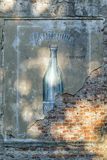 Old bottle wall sign. Old advert showing glass bottle painted on a brick wall stock images