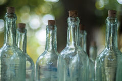 Old bottles on an antique market. Old empty bottles on an outdoor antique market royalty free stock photography