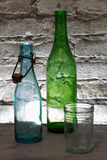 Old bottles and a glass Royalty Free Stock Photo