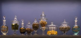 Old bottles of medicinal herbs. Set of old bottels with medicinal herbs in an old pharmacy in Florence, Italy stock photography
