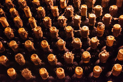 Old bottles of wine in the dust Stock Images