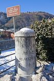 Old boundary stone in Pontebba Italy Royalty Free Stock Photo