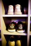 Old  bowling shoes placed in the cupboard, vertical frame. Stock Images