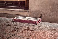 Old bowls for animals fed on sidewalk. Close view stock photo