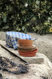 Old bowls and plates stacked together on old wood Royalty Free Stock Photography