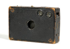Old box camera. An old box camera with worn edges stock photo