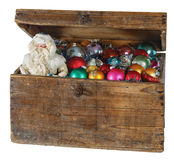 Old box with Christmas decorations and Santa Claus. Isolated royalty free stock photography