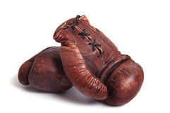 Old boxing gloves. A pair of old brown boxing gloves  on white background Stock Images