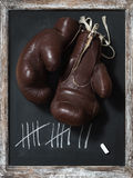 Old Boxing Gloves on Chalkboard with Tally Sheet Royalty Free Stock Photos