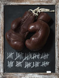 Old Boxing Gloves on Chalkboard with Tally Sheet Stock Image