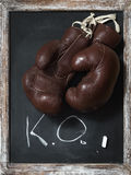 Old Boxing Gloves on Chalkboard with Text Royalty Free Stock Image