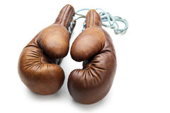 Old boxing gloves isolated on white stock images