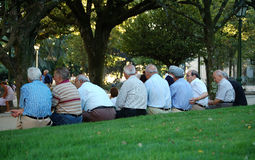 Old Boys Club in Paseo de la Alameda - Santiago de Compostela. Male senior citizens enjoy some pleasant time together in the park Paseo de la Alameda in Santiago Stock Photo