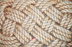 Old braided dirty door-mat Stock Images