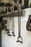 Old branding irons. Old branding irons in the barn royalty free stock image