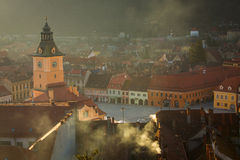 Old Brasov city buildings roof, The Council House clock tower on Stock Images