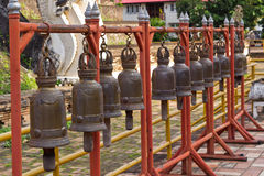 Old Brass Bells. Hanged in the Thailand Buddist  Temple (Wat Stock Photo