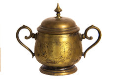 An old brass or bronze metal sugar bowl with a lid and ornament. Metal punctles with scratches and patina. Royalty Free Stock Photos