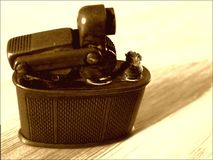 Old brass cigarette lighter close-up stock photography