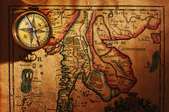 Old brass compass over antique Thailand map. Beautiful old brass compass over antique Thailand map royalty free stock photography